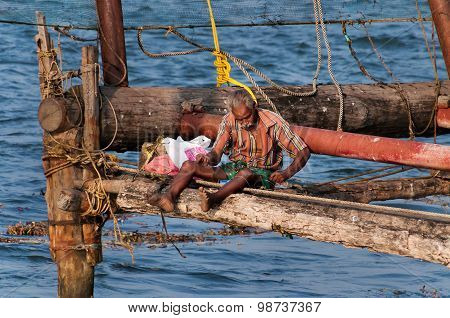 Fisherman On Chinese Fishing Nets