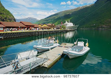 View to boats tied at the Flam railway station pier in Flam, Norway.