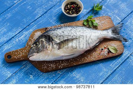 Fresh Dorado Fish On A Blue Wooden Background
