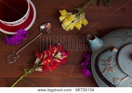 Teapot And Cup On Wooden Table