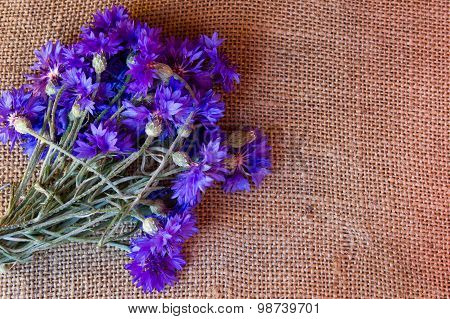 Cornflowers On The Old Burlap Table, Rustic With Copy Space
