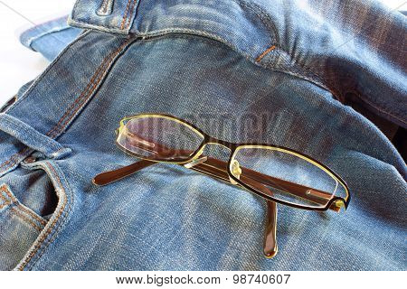 Modern Glasses On Jeans Background
