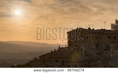 Typical Italian town Volterra overlooking Tuscany during sunset