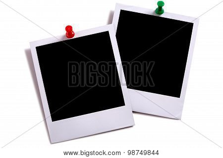Two Blank Instant Camera Photo Prints With Green And Red Pushpins Isolated On White With Shadow.
