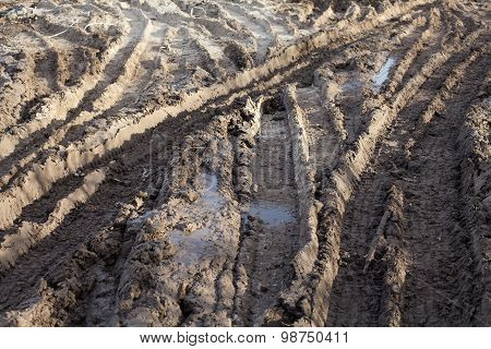 Wheel Ruts On The Muddy Dirt Road
