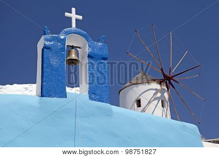 Bell Tower And Windmill In Oia Village, Santorini, Greece