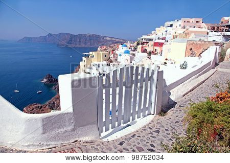 Entrance White Gate With The Buildings, Oia, Santorini, Cyclades, Greece.