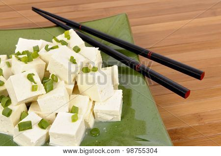 Tofu Cubes With Chopsticks