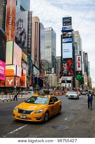 NEW YORK, USA - AUGUST 7, 2015: A yellow cab drives past Times Square.