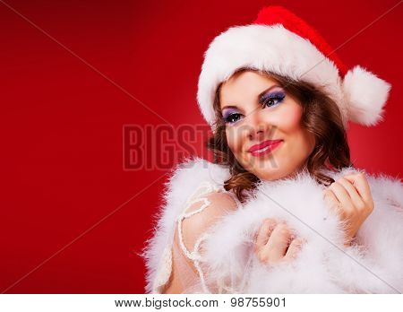 beautiful woman against red background, Christmas topic