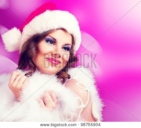beautiful woman against colorful pink background, Christmas topic