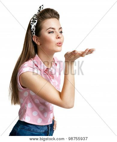 Young Attractive Woman Blows A Kiss
