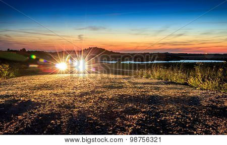 Car With Bright Light In Beautiful Mountain Landscape Sunset Sunrise