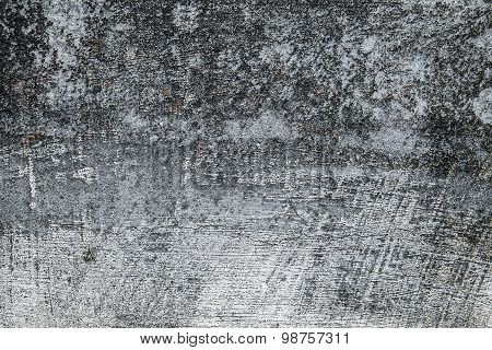 Cracked grunge concrete wall texture background.