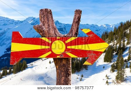 Macedonia Flag wooden sign with winter background