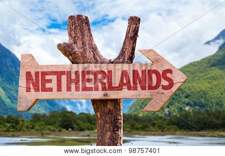 Netherlands wooden sign with mountains background