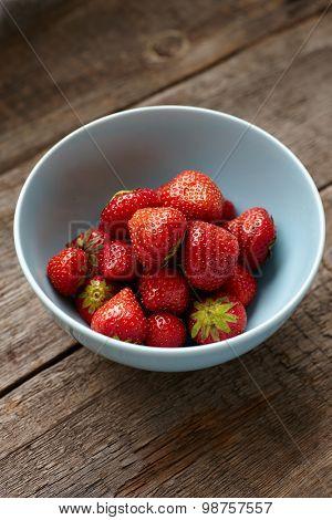 Strawberry in a blue ceramic bowl