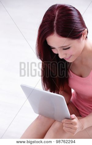 Woman Smile Using Tablet Pc