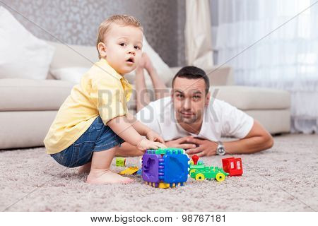 Attractive man is spending time with his child
