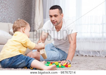 Pretty father and child are spending time together