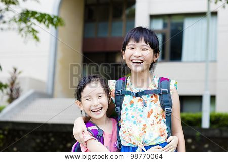 Happy Little Girls With Classmates Having Fun At The School