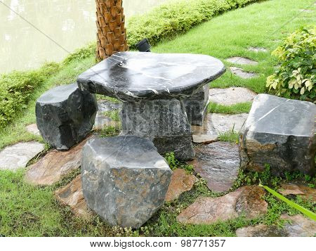 Stone Chair And Desk In The Garden