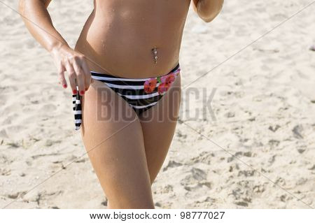 Waist Of The Beautiful Woman On A Beach