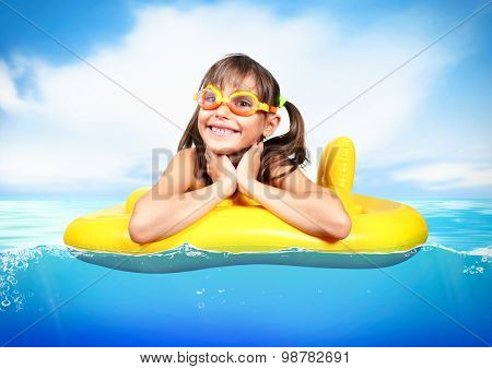 Funny Little Girl With Diving Glasses Floating Inflatable Ring At Sea, Vacation Concept