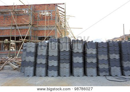 Black Tiles Roof In Building Construction Site