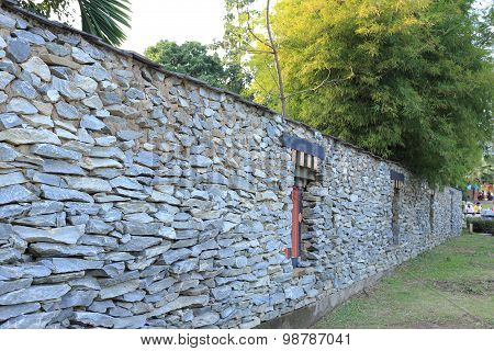 Bhutan Style Fence Stone And Decorated Garden With Bamboo