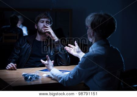 Suspected Man Smoking A Cigarette