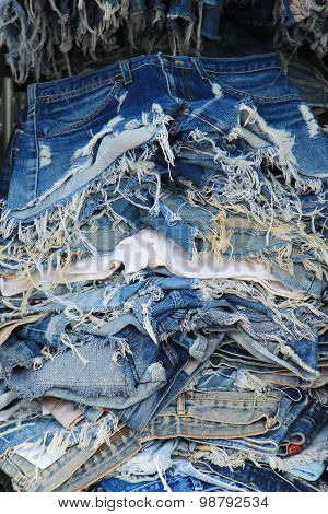 Stack Of Torn Old Jeans