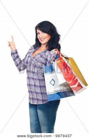 Woman With Shopping Bags Pointing