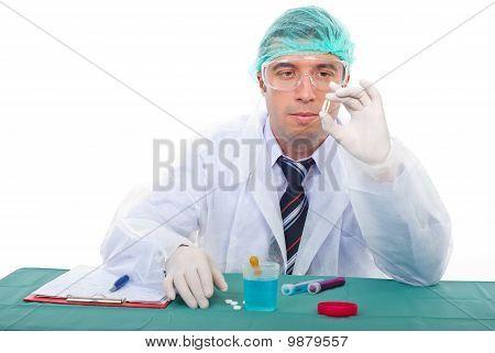 Laboratory Man Examine Oil Capsule