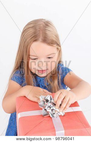 Little girl holding present