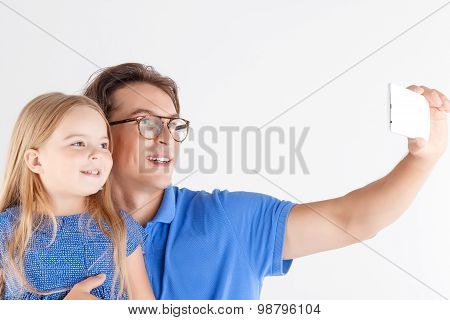 Father and daughter making photos