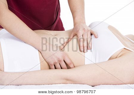 physiotherapist gets diaphragm massage to a woman patient