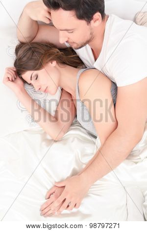 Beautiful couple lying in bed