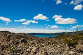 picture of obsidian  - obsidian flow in Oregon with paulina lake as a background - JPG