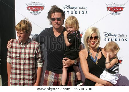 """LOS ANGELES - AUG 11:  Dean McDermott,  Tori Spelling, & Children arrives to Disney/Pixar Celebrates The Launch Of The """"World Of Cars Online"""" at Bob's Big Boy on August 11, 2010 in Burbank, CA"""