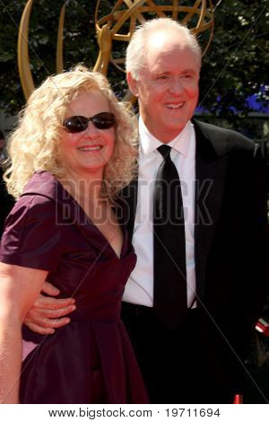 LOS ANGELES - AUG 21:  John Lithgow & wife arrive at the 2010 Creative Primetime Emmy Awards at Nokia Theater at LA Live on August 21, 2010 in Los Angeles, CA