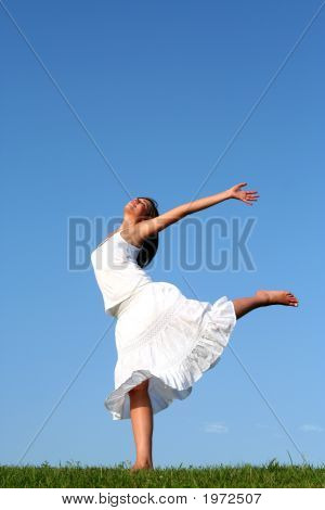 Woman Dancing On Grass