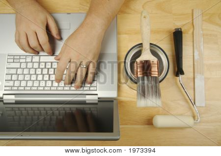 Handyman Researches On Laptop
