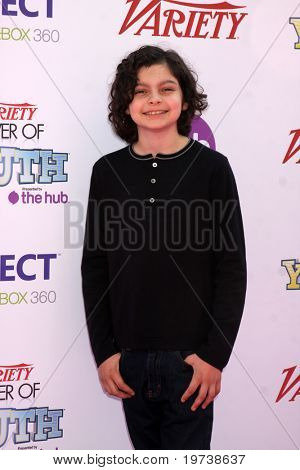 LOS ANGELES - OCT 24:  Max Burkholder  arrives at the Variety Power of Youth Event 2010 at Paramount Studios on October 24, 2010 in Los Angeles, CA