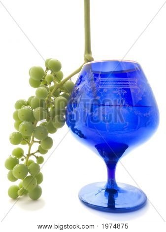 Green Grapes And Dark Blue Glass With A Wine