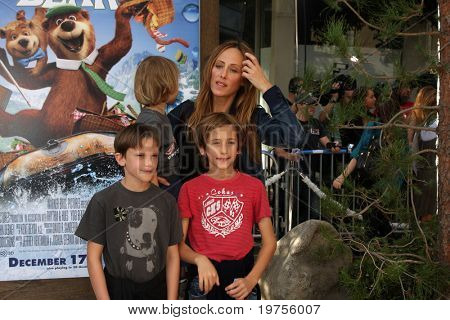 "LOS ANGELES - DEC 11:  Kim Raver arrives at the ""Yogi Bear 3-D"" Premiere at The Village Theater on December 11, 2010 in Westwood, CA."