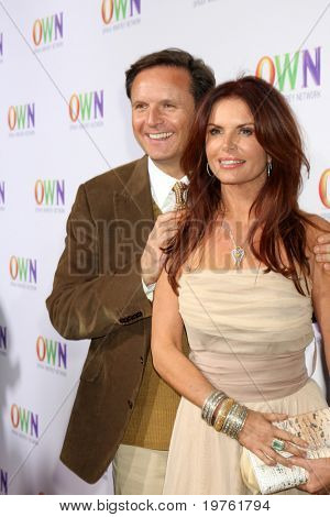 LOS ANGELES - JAN 6:  Mark Burnett, Roma Downing arrives at the Oprah Winfrey Network Winter 2011 TCA Party at The Langham Huntington Hotel on January 6, 2011 in Pasadena, CA.