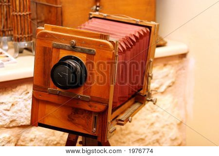 An Old Photo Camera On A Tripod