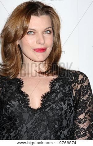 LOS ANGELES - JAN 15:  Milla Jovovich arrives at the Art Of Elysium 'Heaven' Gala 2011 at The California Science Center Exposition Park  on January 15, 2011 in Los Angeles, CA