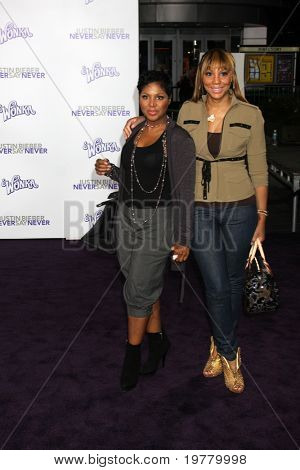 "LOS ANGELES - FEB 8:  Toni Braxton & sister arrive at the ""Never Say Never"" Premiere at Nokia Theater  on February 8, 2011 in Los Angeles, CA"